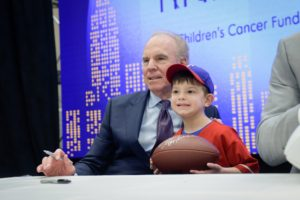 Another former Cowboys quarterback, Roger Staubach, takes a photo with Bennett Towbin.