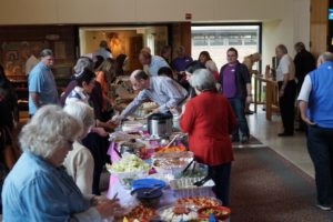 Attendees enjoy the food table.