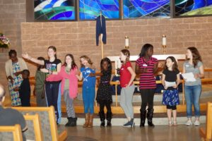 Children from Beth Shalom Congregation sing at the Interfaith Potluck.