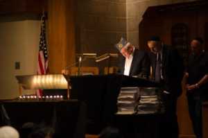Photo: David Duchin/dspnphotos.com Participants read names at Congregation Beth Torah's annual 24-hour Holocaust vigil service in 2016.