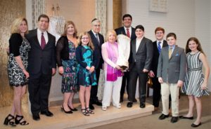 """We've always been very involved in our Jewish community,"" said Helen Risch (center), who celebrated her bat mitzvah on May 13 with her family surrounding her. ""I felt it was my time to focus on my own Jewish learning."" (From left) Alisha, Jonathan, Jolene, Maddie, Frank, Aaron, Jeremy, Eli, Jake and Rebecca."