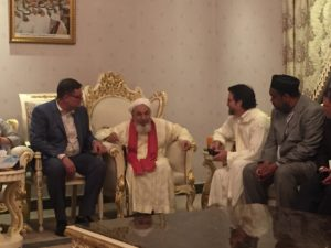 Sheikh Abdullah Bin Bayyah (center) with Pastor Bob Roberts (left) at a gathering at the Sheikh's home