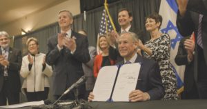 Photo: Office of Governor Gregg Abbott Texas Gov. Gregg Abbott displays the legislation after he signed the bill into law.