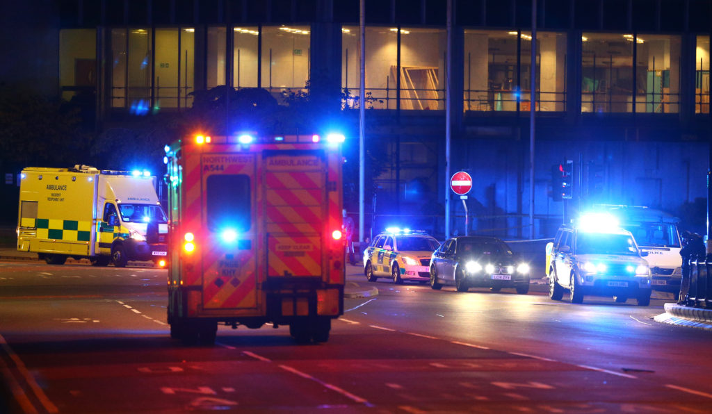 MANCHESTER, ENGLAND - MAY 23: Emergency services arrive  close to the Manchester Arena on May 23, 2017 in Manchester, England.  There have been reports of explosions at Manchester Arena where Ariana Grande had performed this evening.  Greater Manchester Police have confirmed there are fatalities and warned people to stay away from the area. (Photo by Dave Thompson/Getty Images)