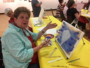 Submitted photo Carole Rogers brushes up on painting at Painting with a Twist Donorpalooza.