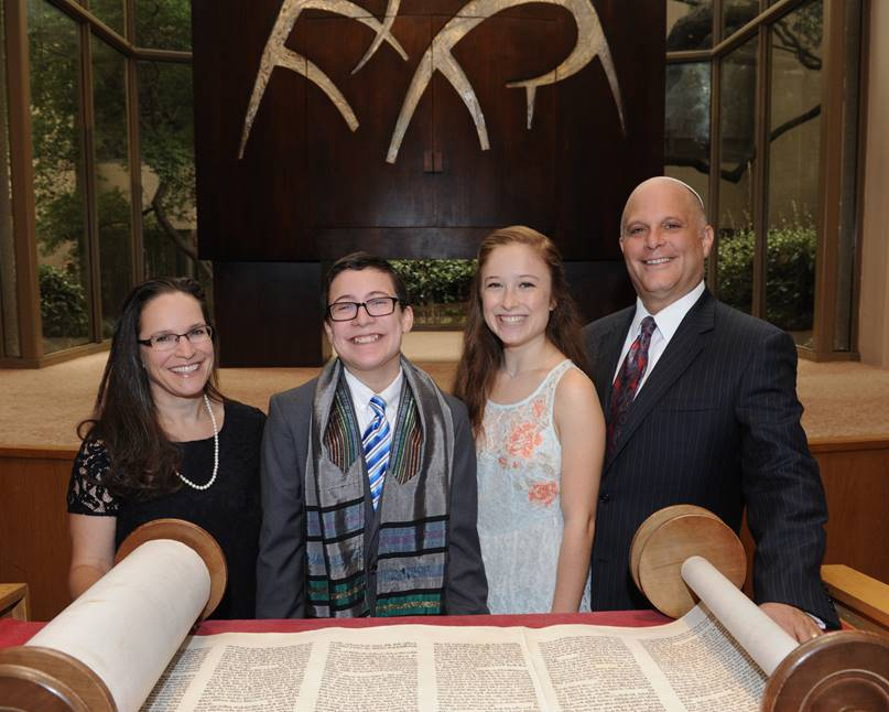 "Photo: Winn Fuqua Rabbi Andrew Paley will celebrate 13 years, his ""bar mitzvah,"" at Temple Shalom, with his family (left to right) Debbie, Sammy, Molly, his congregation and the community beginning this Friday, Aug. 18, at 6 p.m."