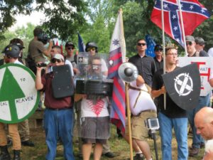 White supremacists rally in Charlottesville, Va., Aug. 12, 2017. (Ron Kampeas) Holding Nazi flags, white supremacists march at a park in Charlottesville, Va., protesting the removal of a statue of Confederate Gen. Robert E. Lee, Aug. 12, 2017. (Ron Kampeas_