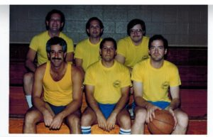 Jeff Kaitcer (back left) and Lenny Herzfeld (front middle) were in a 1980 basketball league.
