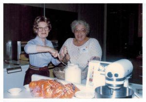 Lillian Bellows and Matti Joseph prepare food in 1980.