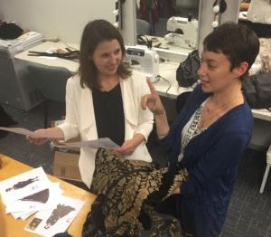 Photo: Illana Stein Director Illana Stein (left) and costume designer Izzy Fields discuss costume options for A Lost Leonardo. The play runs through Nov. 5 at Amphibian Stage in Fort Worth.