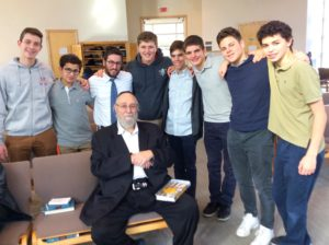 (From left) Leib Malina, Eli Burstein, Rabbi Yoni Sonenblick, Simcha Malina, Ari Berke, Yosef Weiss, Jonah Eber and Daniel Garren enjoy a moment with Rabbi Chaim Kramer (seated) at Yavneh.