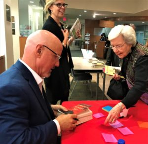 Beneath A Scarlet Sky author Mark Sullivan autographed a personal message for Tycher Community Read guest Hanna Lambert, with JCC Director of Israel Engagement and Jewish Living Rachelle Weiss Crane, still smiling about last week's record-breaking BookFest crowd of more than 325.