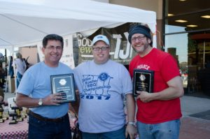 "Event chair Brian Rubenstein is flanked by ""Celebrity's Choice Turkey Winners"" Jim Liston, left and Jeff Kort of Meat-Fire-Mishpacha."