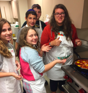 Submitted photo Beth Torah Chugim teens prepare Shabbat dinner prior to their student-led service.