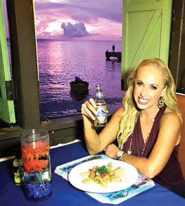 Enjoying a great meal in St. Lucia, Linda Cooper who is the executive producer and host of Travel Time with Linda, which begins airing in January on AXS TV, has an appetite for sharing the most beautiful of the world, and the best tastes too.
