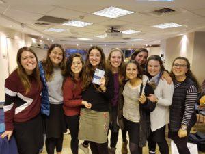 Rosie Bernstein, surrounded by her friends, holds her Teudat Zehut (Israeli identification) that she received Dec. 6.