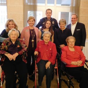 (Back row, from left) Carol Sobaol, Laura Levy, Rivae Campo, Officer David Tilley, Peggy and David Millheiser; (front row) Helen Wunsch, Dottie Lombardi, Ruth Altman