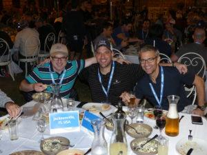 Rabbi Nasanya Zakon, Mike Stern and Billy Warshauer enjoy dinner.